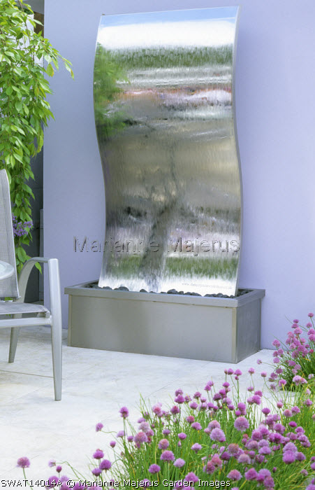 Stainless steel water feature, painted wall