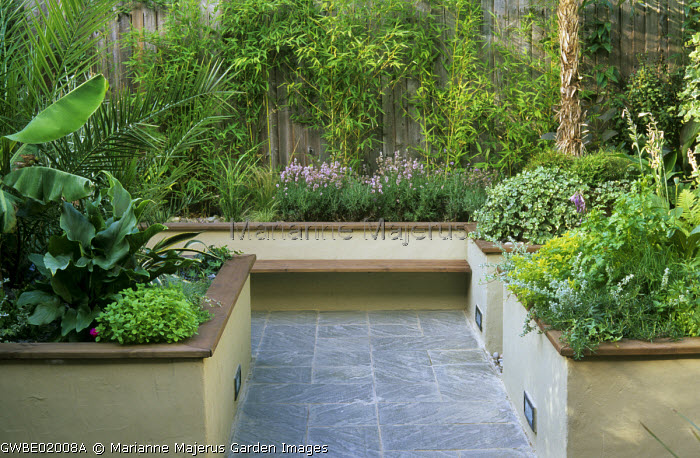 Raised beds, slate paving, bamboos