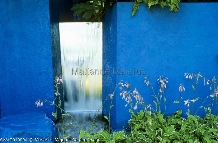 Mirror, waterfall, hostas, blue painted wall