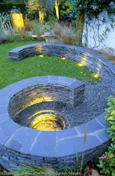 Spiral lit slate paddlestone wall, circular terrace