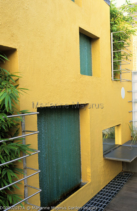 Vertical garden, yellow painted wall, water wall fountain