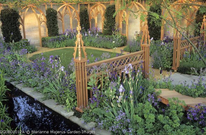 Gothic timber trellis and pergola, irises