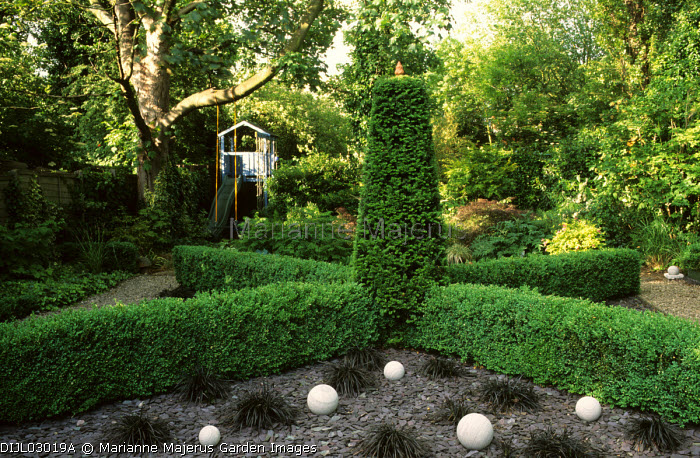 Box and yew hedges, slate mulch, stone balls, Ophiopogon planiscapus 'Nigrescens'