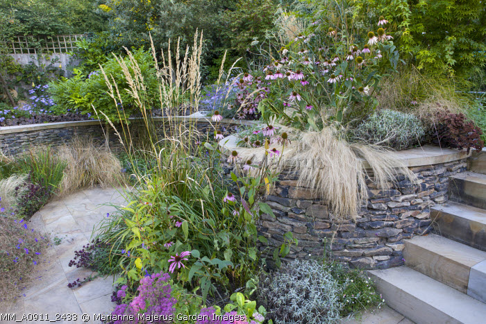 Stone raised bed with autumn planting