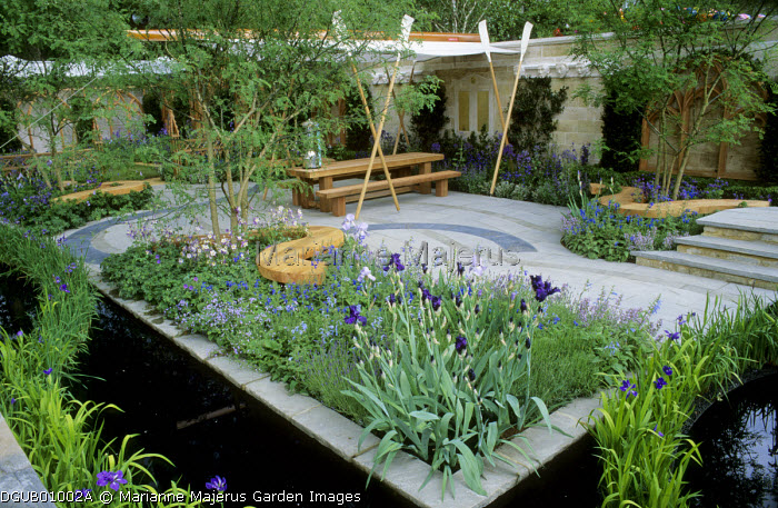 Irises in border, awning supported by oars