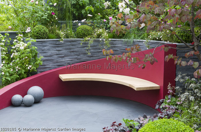 Contemporary urban garden, red painted bench, patio