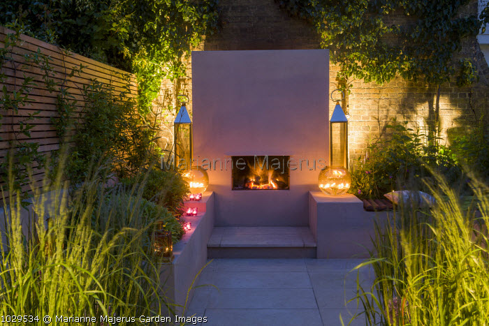 Portuguese honed limestone paving, rendered fireplace and raised beds
