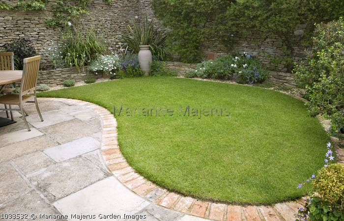 Brick-edged patio, assymetrical curved lawn