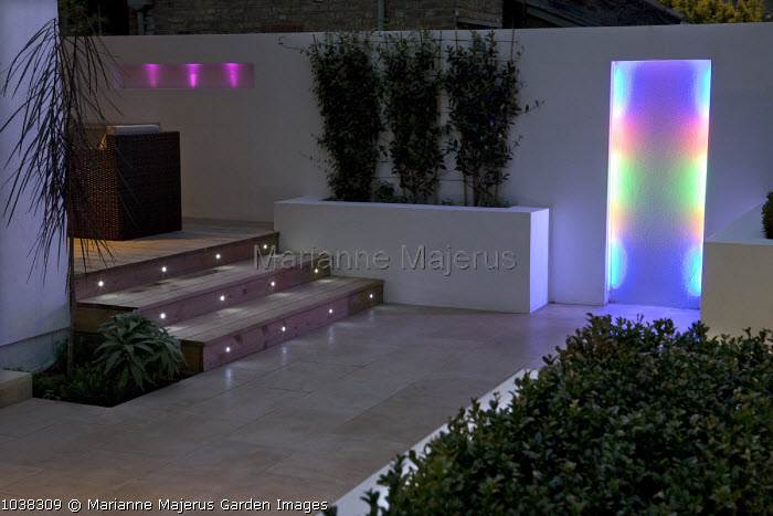 Colourful lighting in recess in contemporary garden