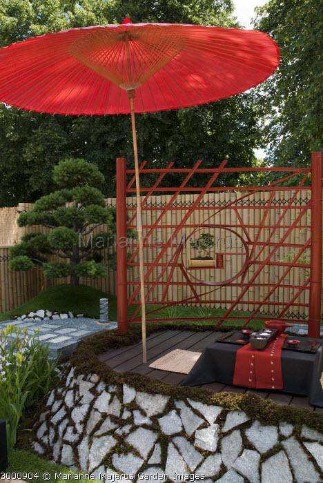 Red umbrella in Japanese garden