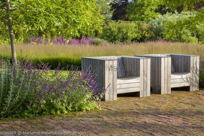 Wooden chairs by Piet Hein Eek, drifts of Molinia caerulea, Phellodendron chinense