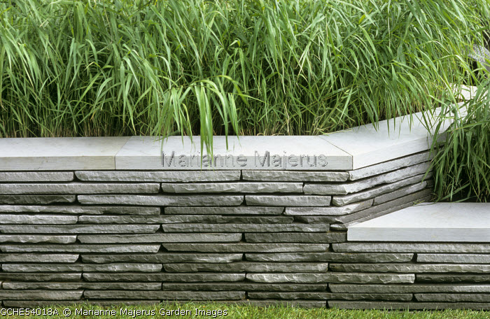 Drystone wall enclosing reed bed, eco-friendly garden