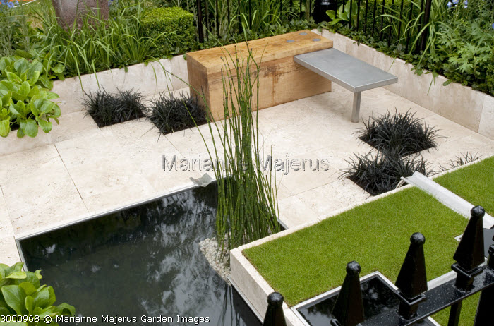 Formal geometric town garden, square raised lawn, timber bench, Ophiopogon planiscapus 'Nigrescens'