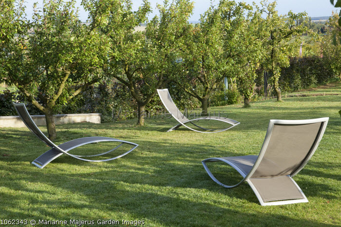 Contemporary loungers in orchard
