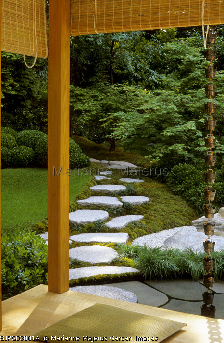 View from tea house to stepping stone path, Japanese rain drain, granite boulders