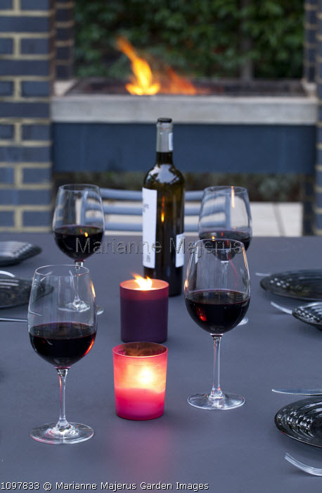 Wine and candles on table for evening barbecue