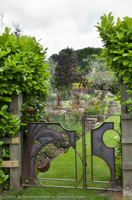 Contemporary gate by Steve Myburgh in laurel hedge