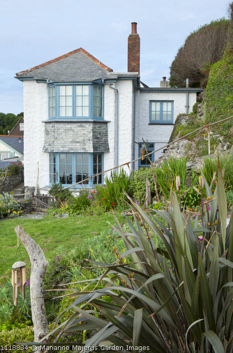Cottage in seaside garden, phormium, wind chimes