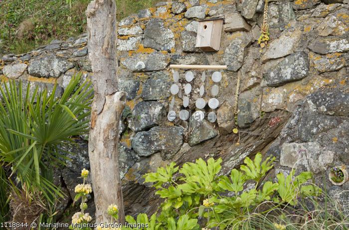 Shell wind chimes, bird box, driftwood
