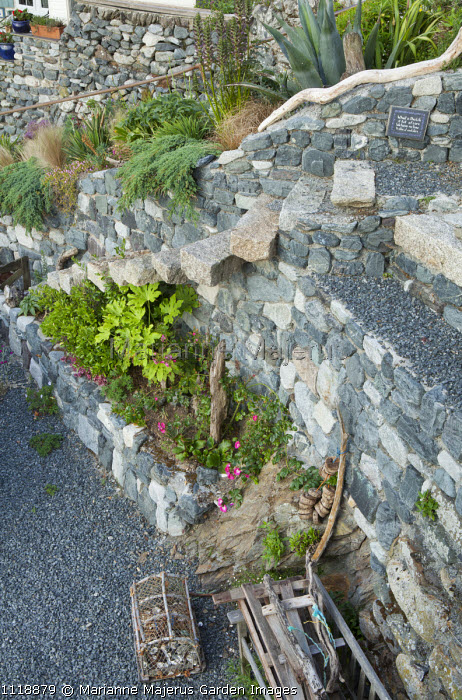 Stone steps jutting out of stone wall