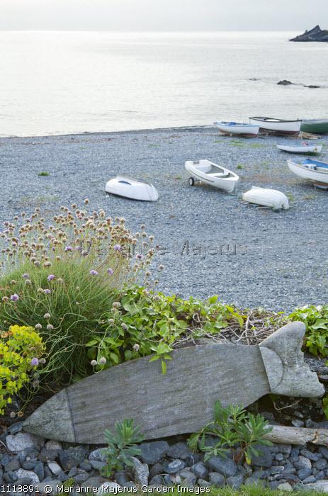 Fish sign, shingle beach, boats, sea