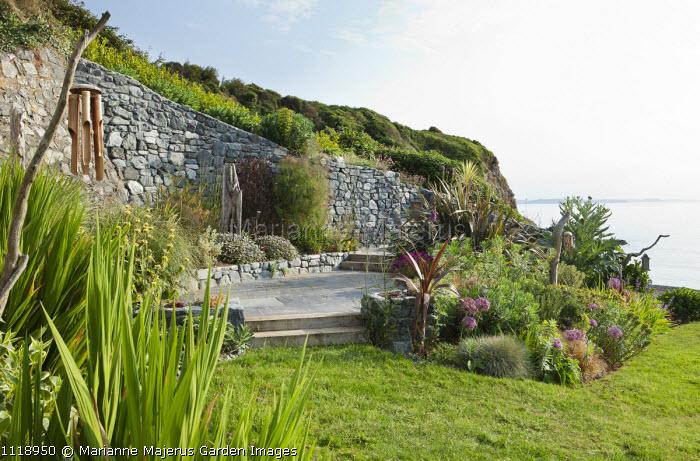 Coastal garden overlooking sea, slate terrace