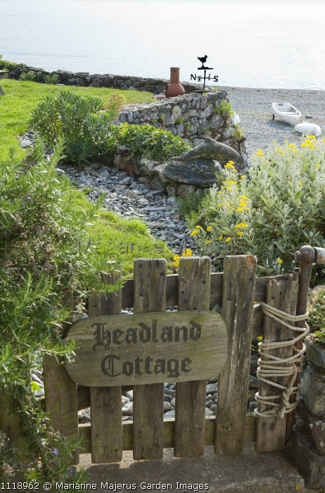 Headland Cottage house name sign on gate, view to shingle beach