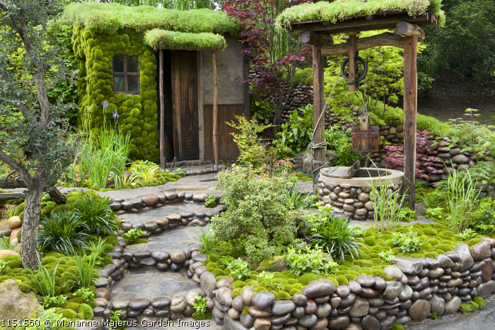 Japanese garden, pebble-egded steps and walls, moss-covered shed, well