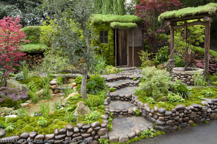 Japanese garden, pebble-egded steps and walls, moss-covered shed, well, pool and waterfall