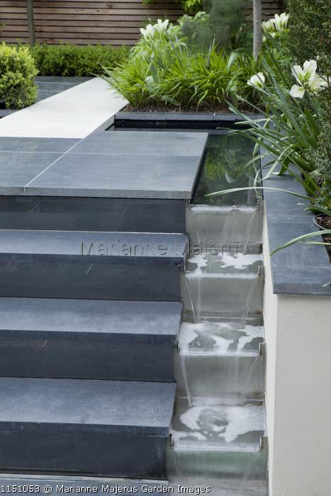 Stepped rill cascade alongside steps