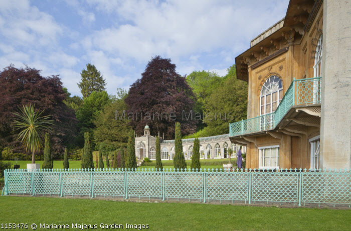 Oriental-style blue painted metal fence, view to Orangery