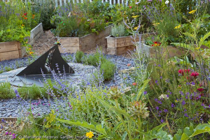 Sundial, raised beds, perovskia, artichokes, linaria, fennel, achillea, lavender, chives