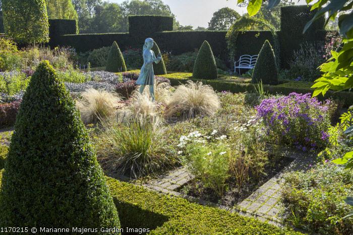 Formal garden, box pyramids, girl statue by Nathan David, Stipa tenuissima, view to bench