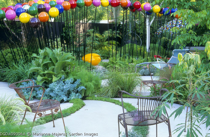 Metal chairs on contemporary patio, colourful metal spheres