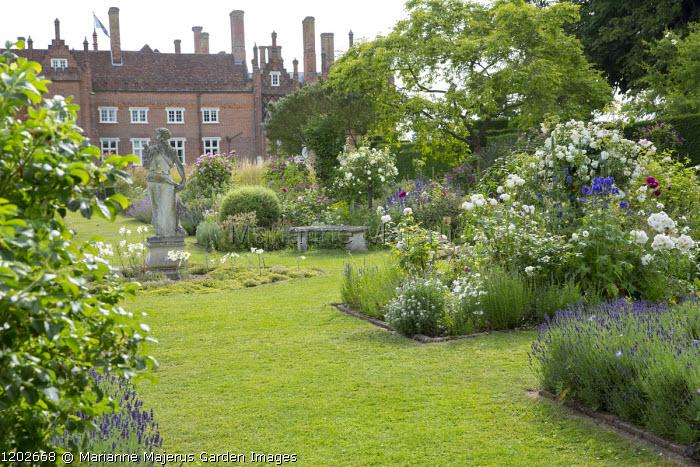 Rose garden, stone statue, lavender, view to house, Rosa 'Albéric Barbier'