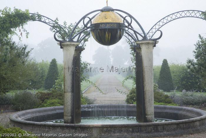 Orb water feature suspended over circular pool, Queen Elizabeth II Golden Jubilee fountain