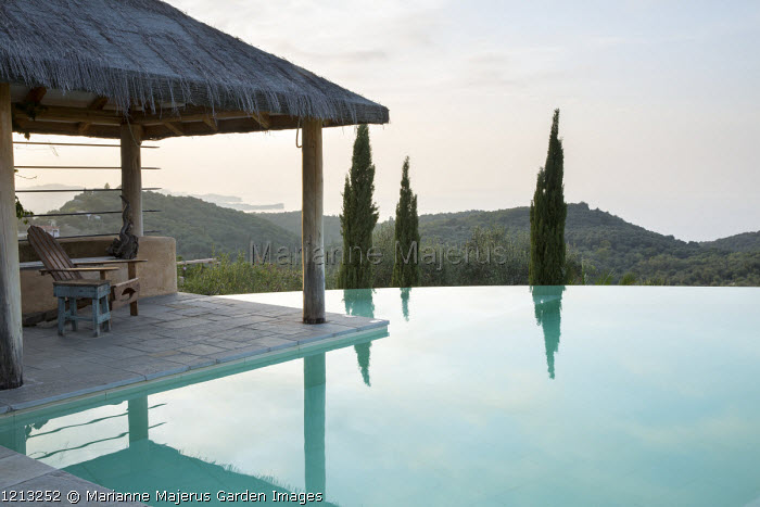 Chair on infinity pool terrace