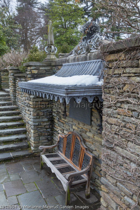 Covered bench on stone patio
