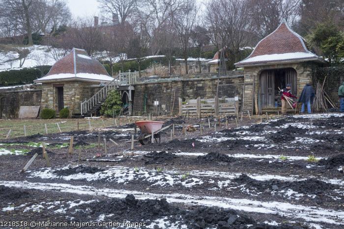 Kitchen garden in winter, wheelbarrow, tool sheds