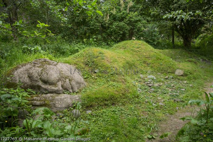 Sleeping figure installation, lawn 'topiary'