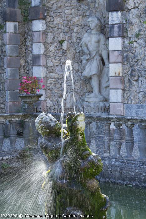 Stone cherub fountain, statue in wall niche