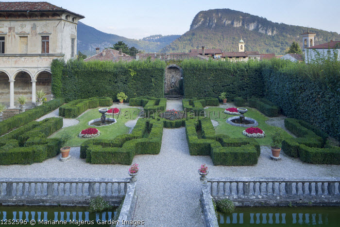 View over formal Italian garden, low clipped box hedges, gravel terrace