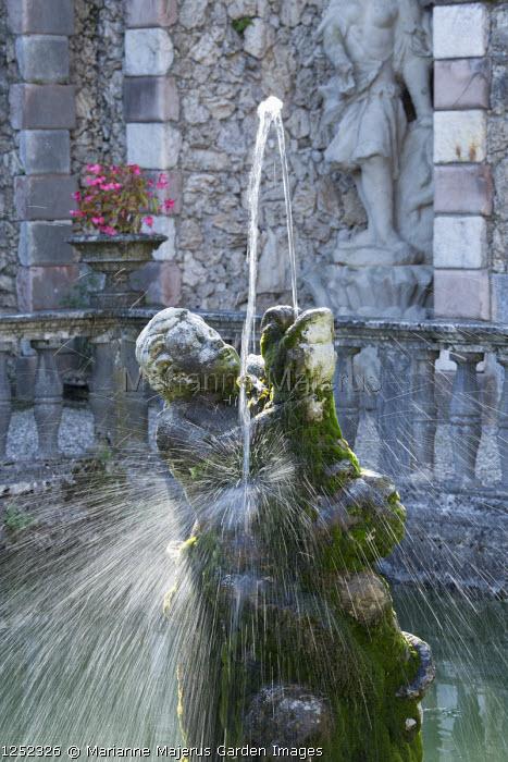 Stone cherub fountain in Italian garden