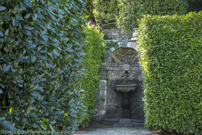 Stone fountain in wall niche