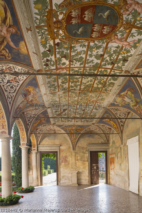 Interior of portico with frescoes by Giulio, Antonio and Vincenzo Campi of Cremona, doorways leading to mediterranean courtyard