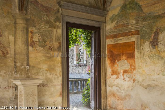 Interior of portico with frescoes by Giulio, Antonio and Vincenzo Campi of Cremona, doorways leading to mediterranean courtyard