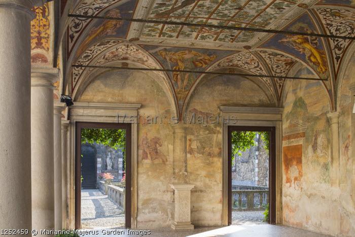 Interior of portico with frescoes by Giulio, Antonio and Vincenzo Campi of Cremona, doorways leading to mediterranean garden