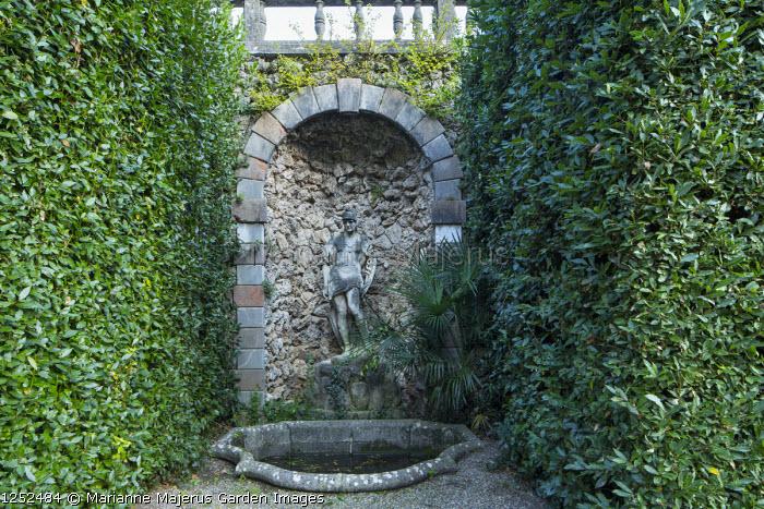 Stone statue in wall niche