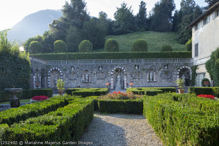 Formal Italian garden, low clipped box hedge parterre, gravel terrace