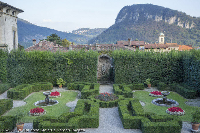 Formal Italian garden, low clipped box hedge parterres, gravel paths